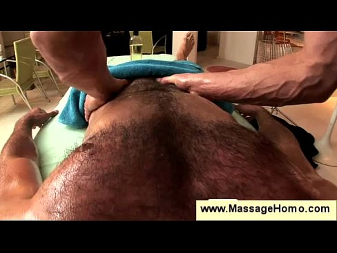 Hairy man enjoys massage by muscled hunk